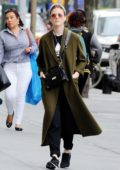 Rose Leslie steps out in an olive green trench coat with Nike sneakers while out and about in New York City
