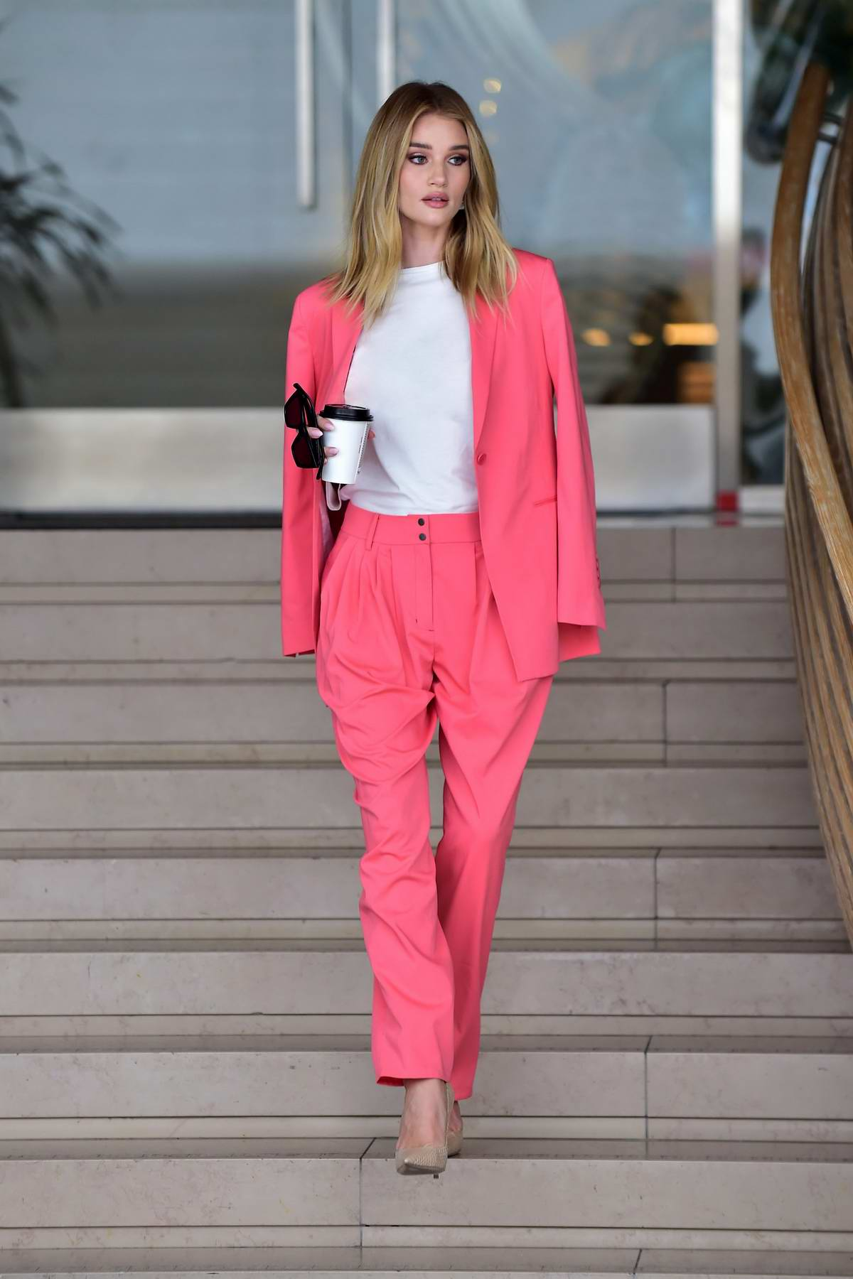 Rosie Huntington-Whiteley looks stunning in a pink pantsuit as she leaves an office building in Beverly Hills, Los Angeles