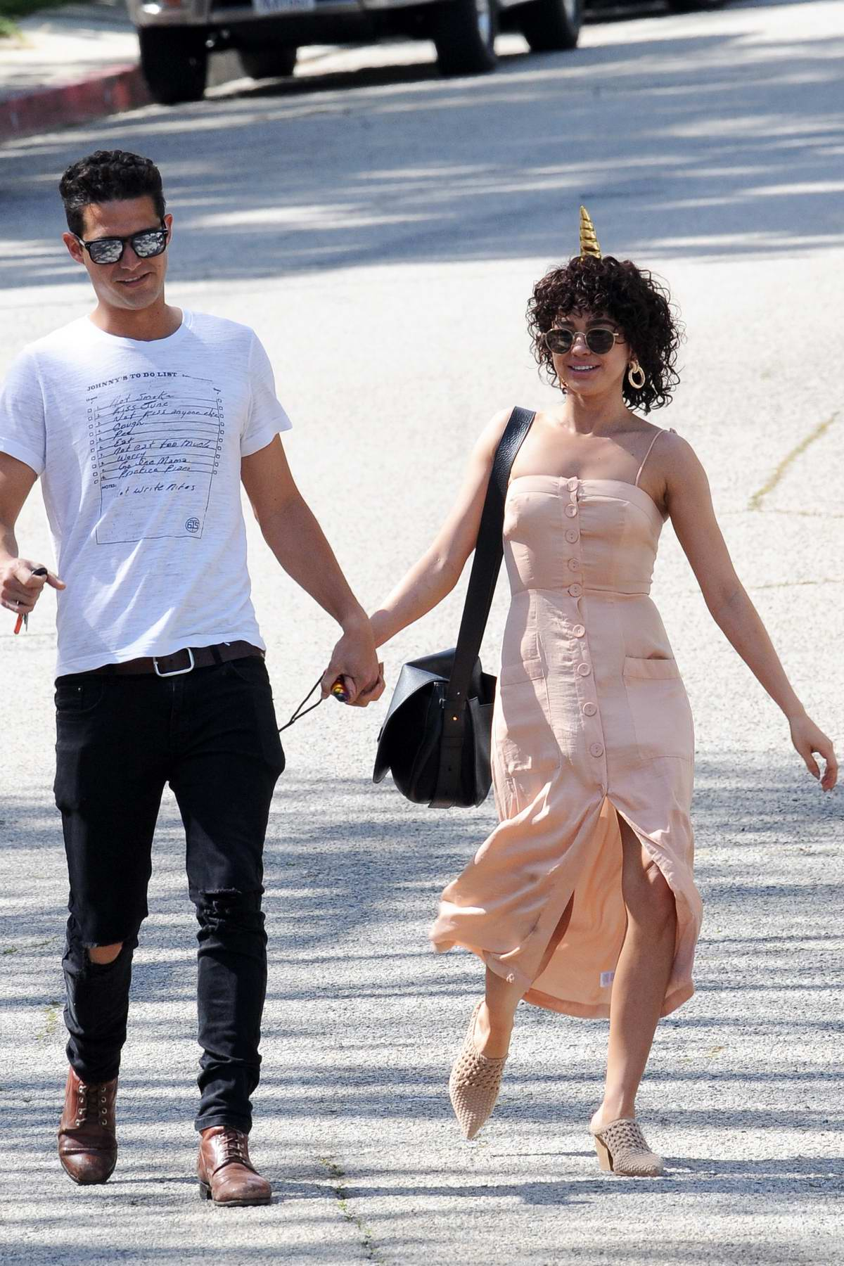 Sarah Hyland attends a kids unicorn theme party with boyfriend Wells Adams in Los Angeles