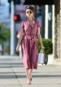 Sarah Hyland looks fashionable in a pink dress while heading out with friends in Los Angeles