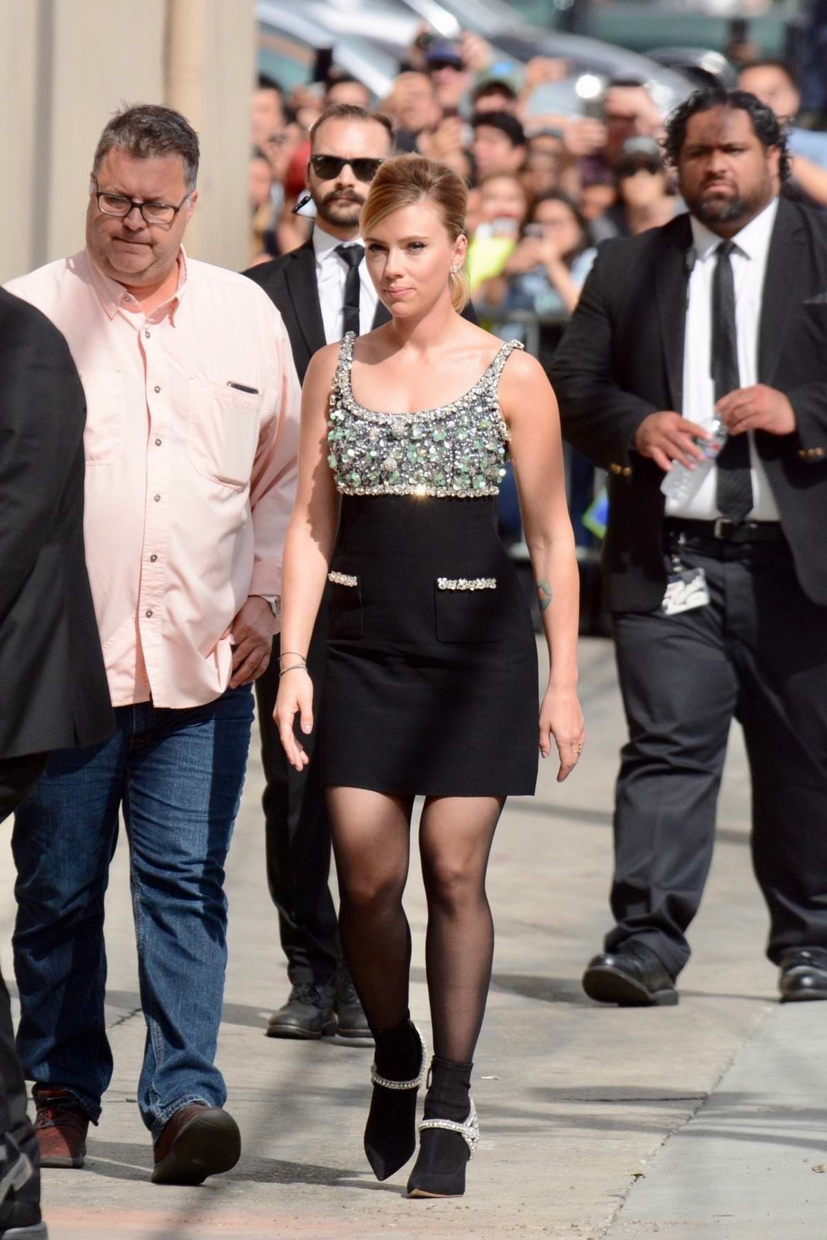 Scarlett Johansson waves for the camera as she arrives for her appearance on Jimmy Kimmel Live! in Hollywood, California