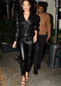 Shanina Shaik rocks black leather ensemble as she leaves Madeo's with DJ Rukus in Beverly Hills, Los Angeles