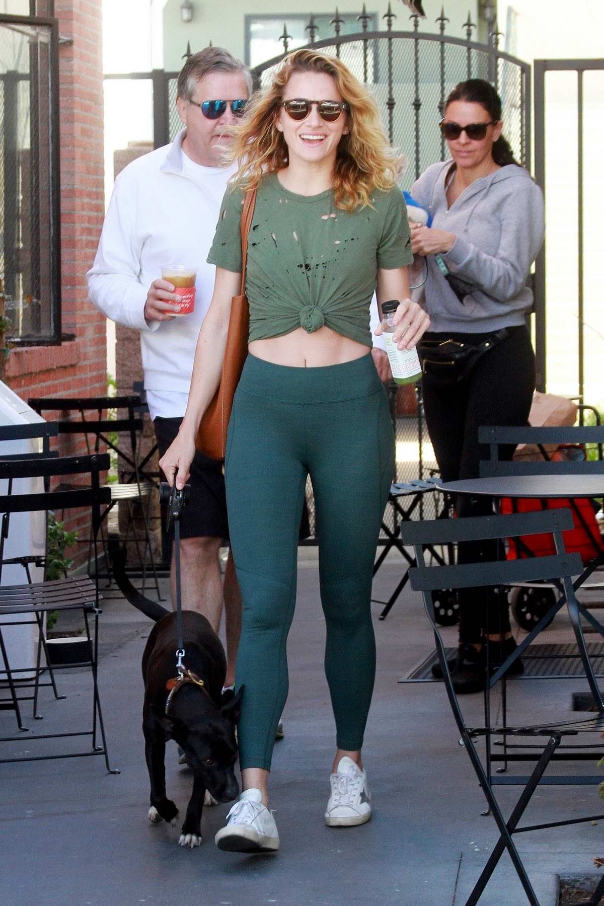 Shantel VanSanten spotted in a green top with matching leggings as she leaves Alfred's with her dog in Los Angeles