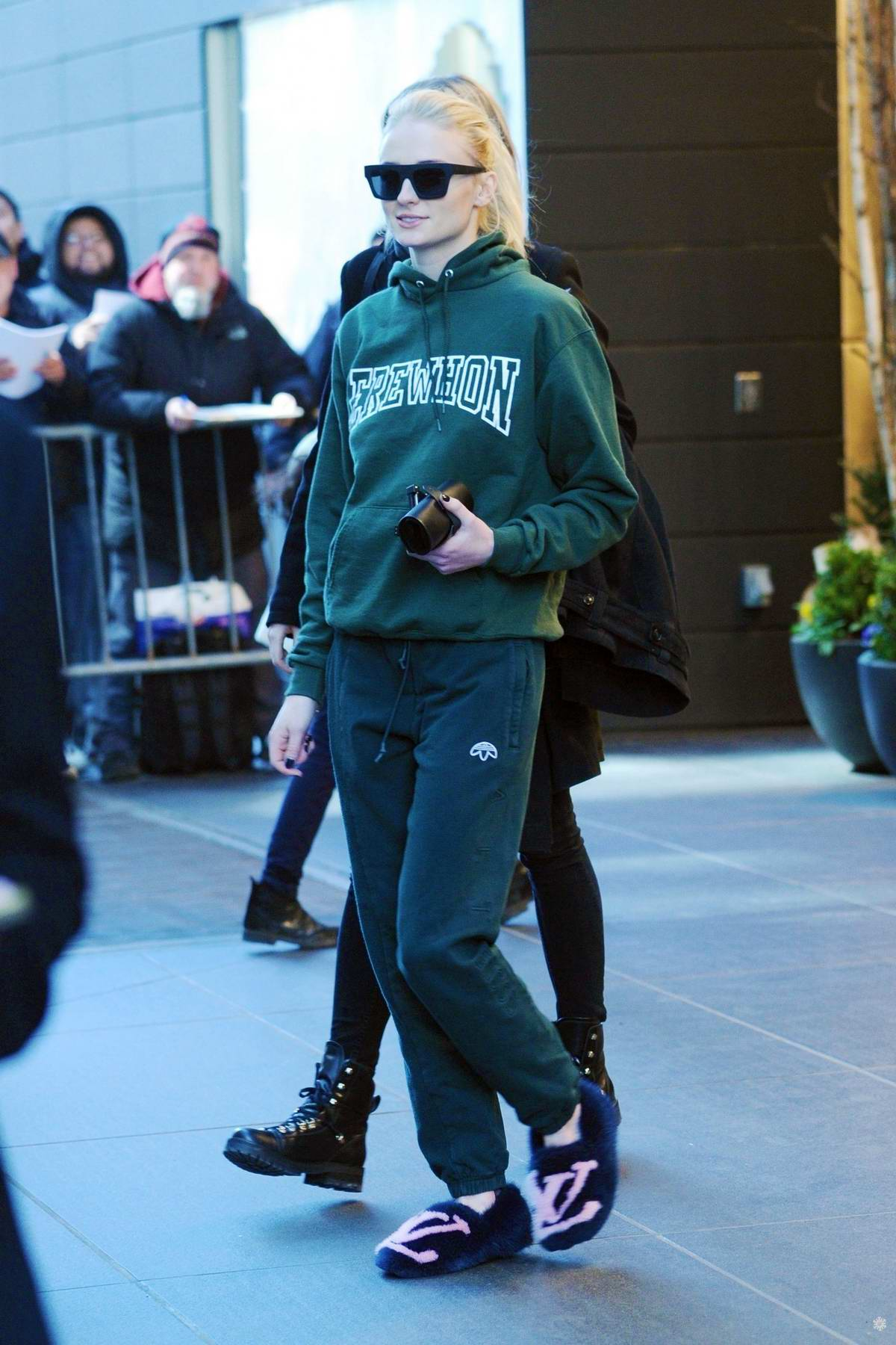 Sophie Turner steps out in green sweats and Louis Vuitton slippers in New York City