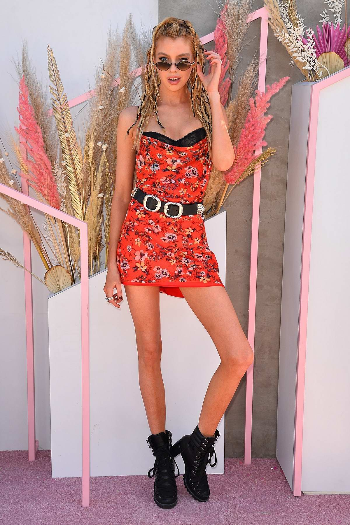 Stella Maxwell looks great in a red floral mini dress at the Revolve Festival during Coachella in Indio, California