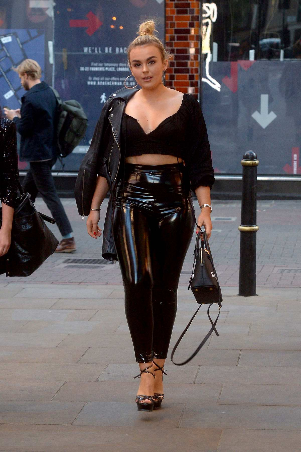 Tallia Storm shows off her style in all black while out in Carnaby Street, London, UK