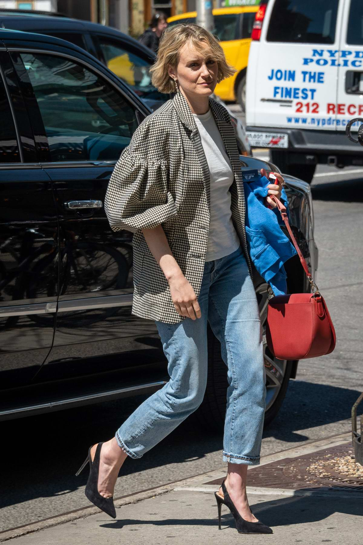 Taylor Schilling rocks a plaid blazer, white top and jeans while out and about in New York City