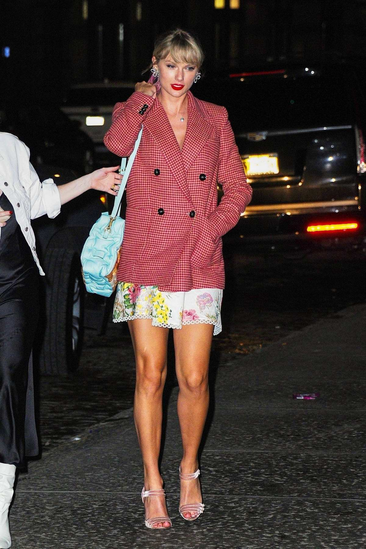Taylor Swift spotted in a red tweed blazer over a floral mini dress as she returns home from Gigi Hadid's birthday in New York City