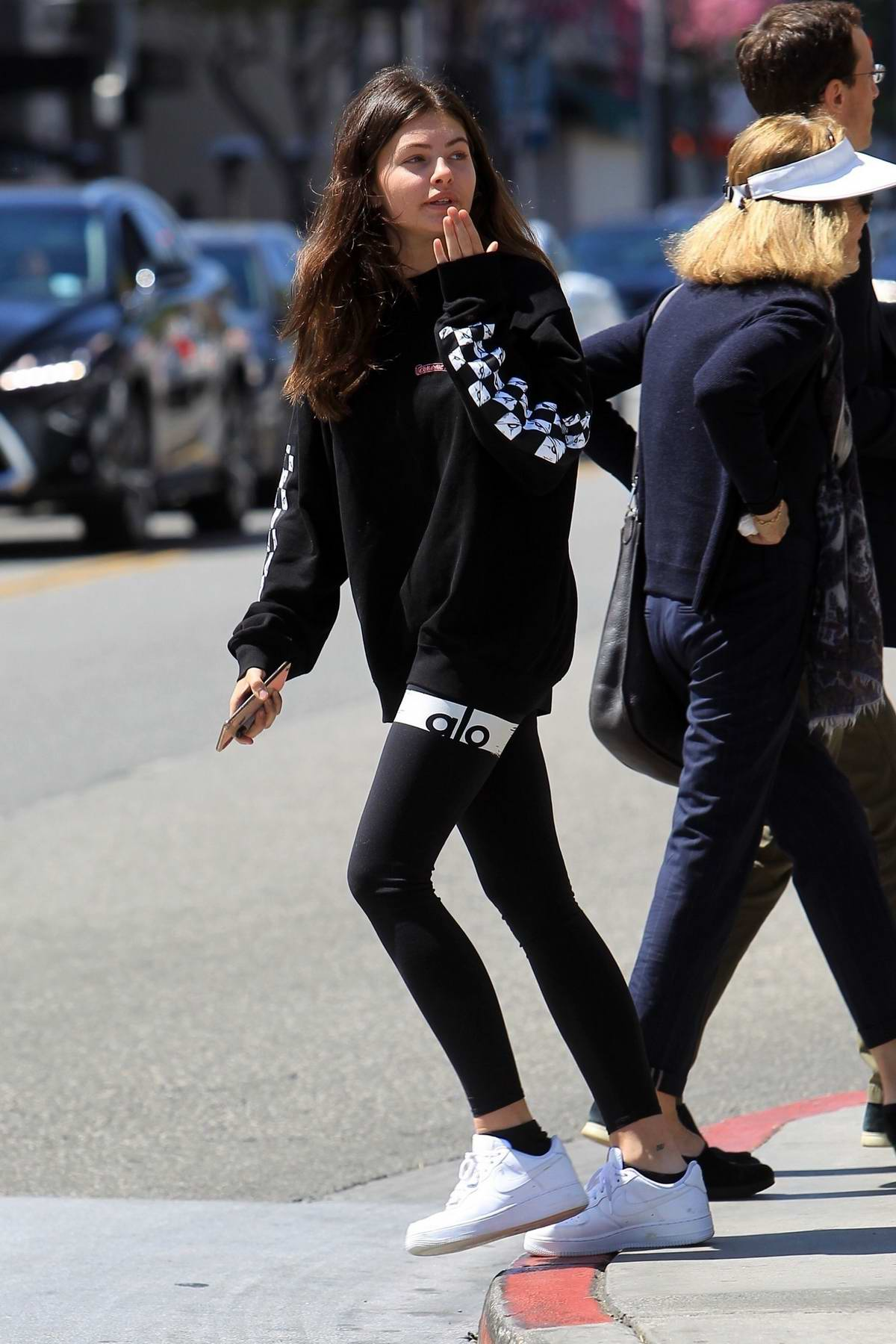 Thylane Blondeau wears a black sweatshirt and leggings during a lunch outing with Milane Meritte in Beverly Hills, Los Angeles