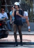 Vanessa Hudgens wears a black tee and leopard print leggings while out for a coffee in West Hollywood, Los Angeles