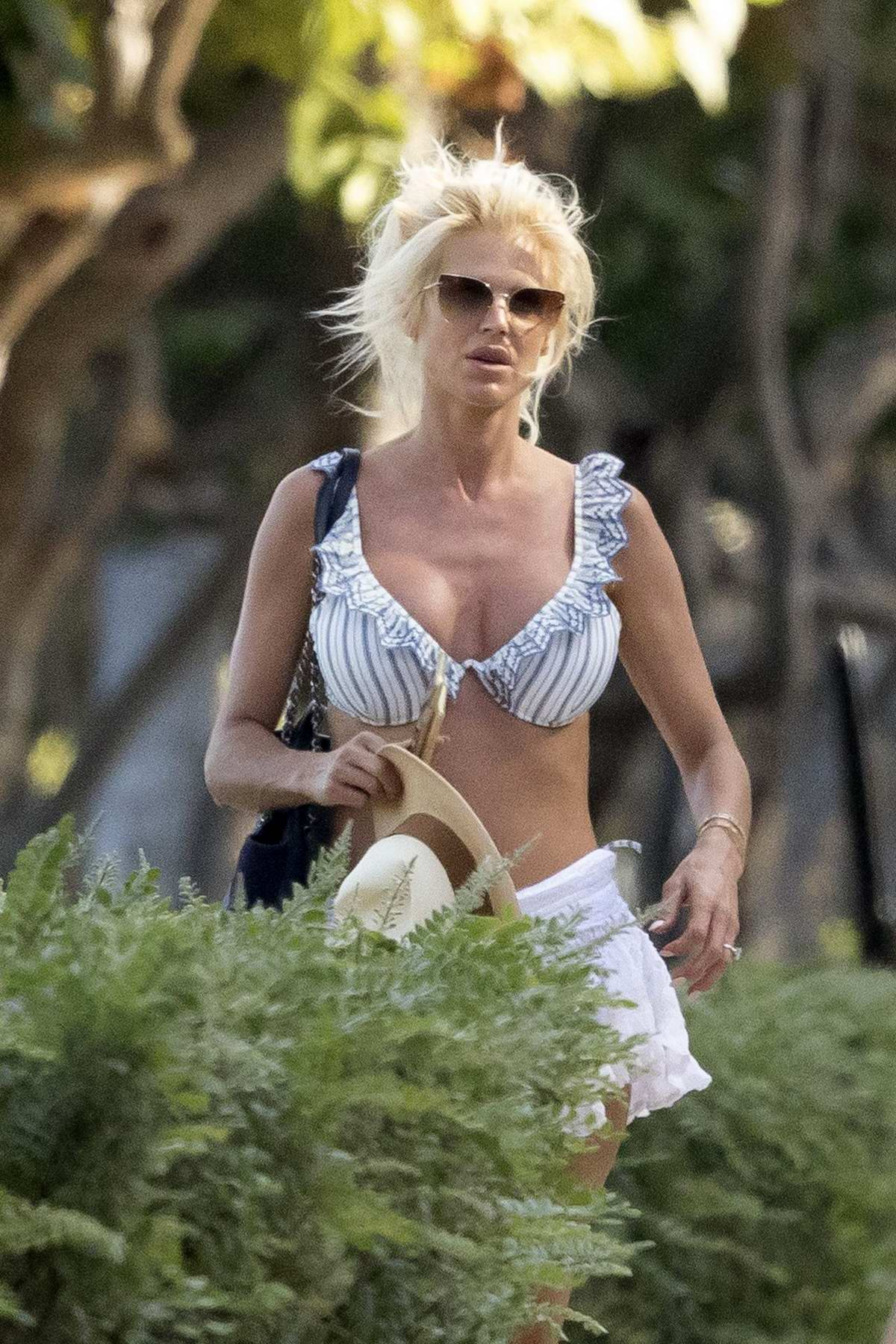 Victoria Silvstedt sports striped bikini as she spends a relaxing day at the beach in Miami, Florida