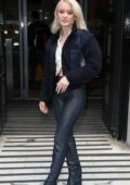 Zara Larsson wears oversized hoop earrings and blue jacket while arriving at BBC Studios in London, UK