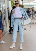 Adriana Lima sports double denim as she arrives at the Martinez hotel during the 72nd annual Cannes Film Festival in Cannes, France