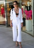 Alessandra Ambrosio looks radiant in white as she steps out on the Croisette during the 72nd Cannes Film Festival in Cannes, France