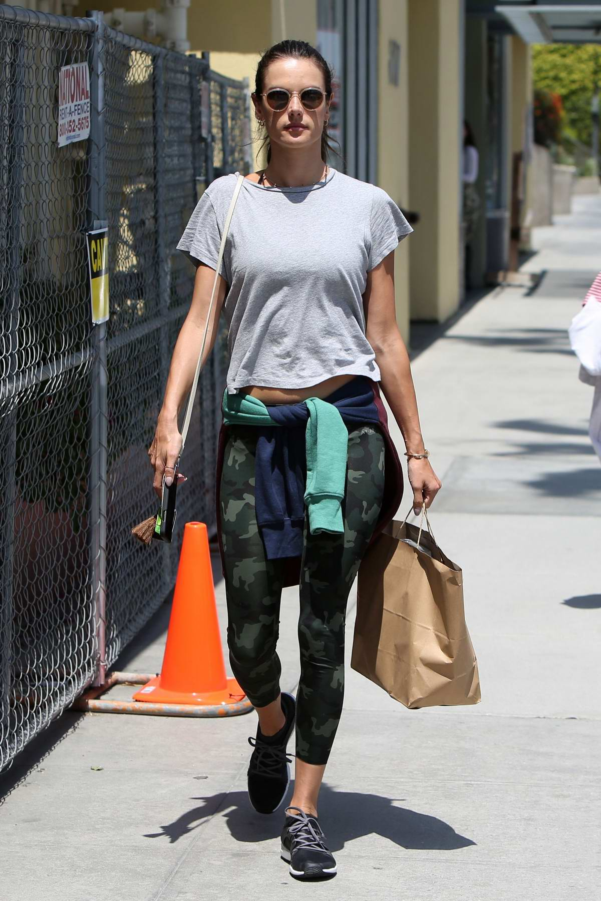 Alessandra Ambrosio rocks a grey top and Camo leggings while out for lunch with her daughter in Brentwood, Los Angeles
