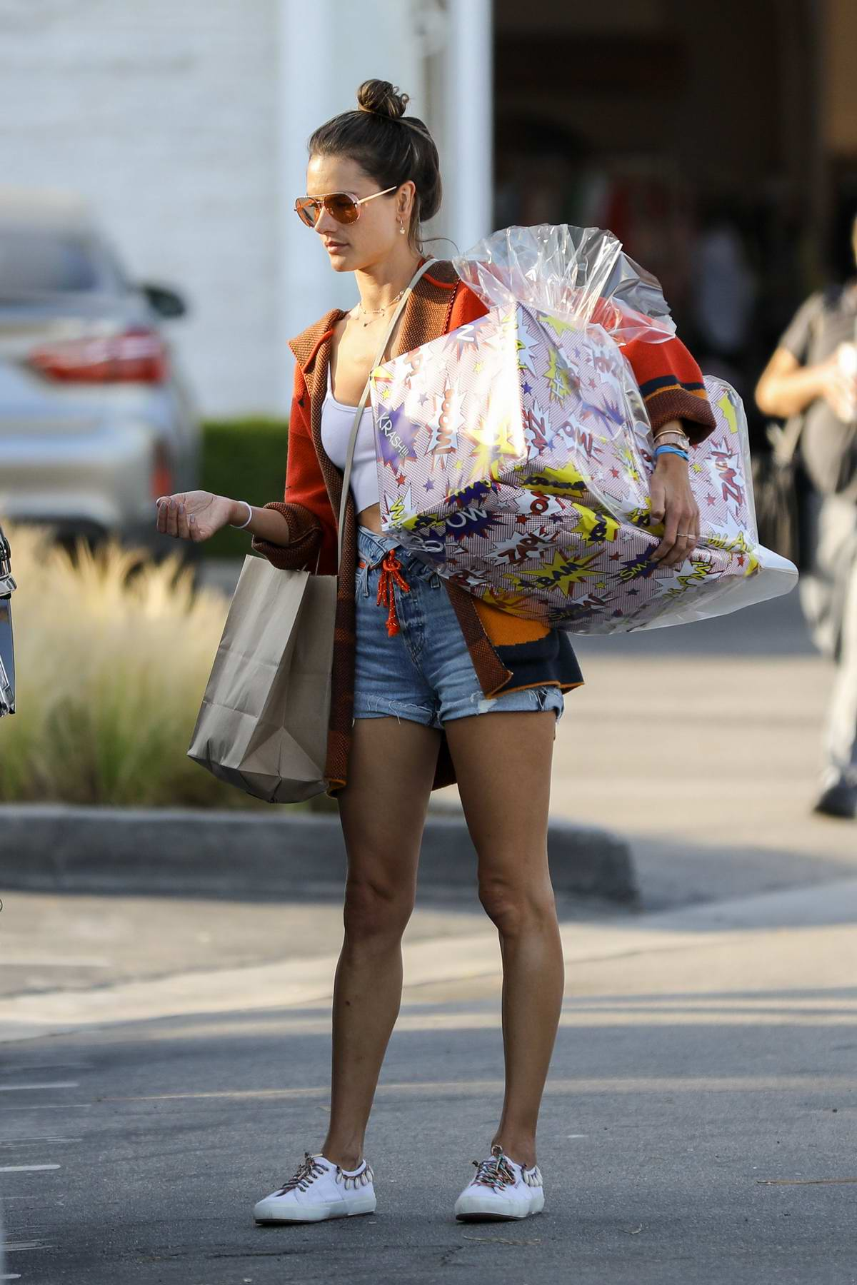 Alessandra Ambrosio steps out in denim shorts and a colorful vest for some shopping with her son in Malibu, California