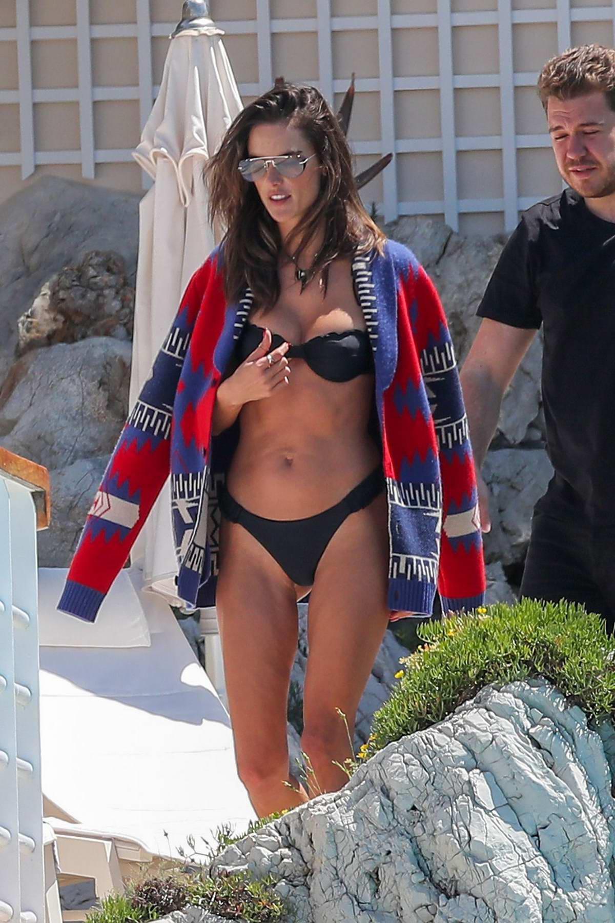 Alessandra Ambrosio stuns in a black bikini at Eden Roc Hotel in Cannes, France