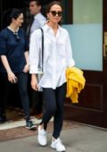Alicia Vikander keeps it simple in a white shirt, black pants and white sneakers while stepping out in Tribeca, New York City