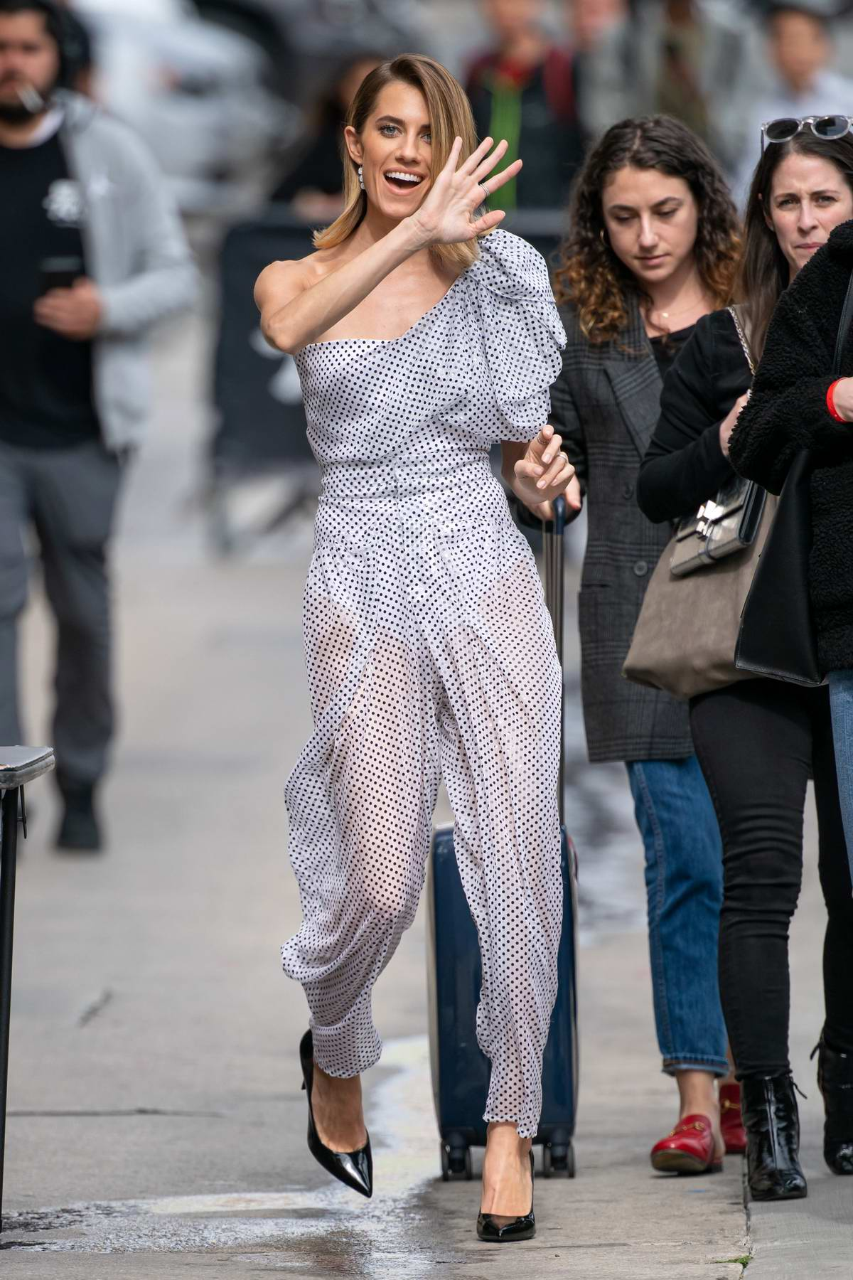 Allison Williams waves to the camera as she arrives for an appearance on Jimmy Kimmel Live! in Hollywood, California