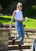 Amber Heard shows off her toned midriff in a white cropped top as she heads out in Los Angeles