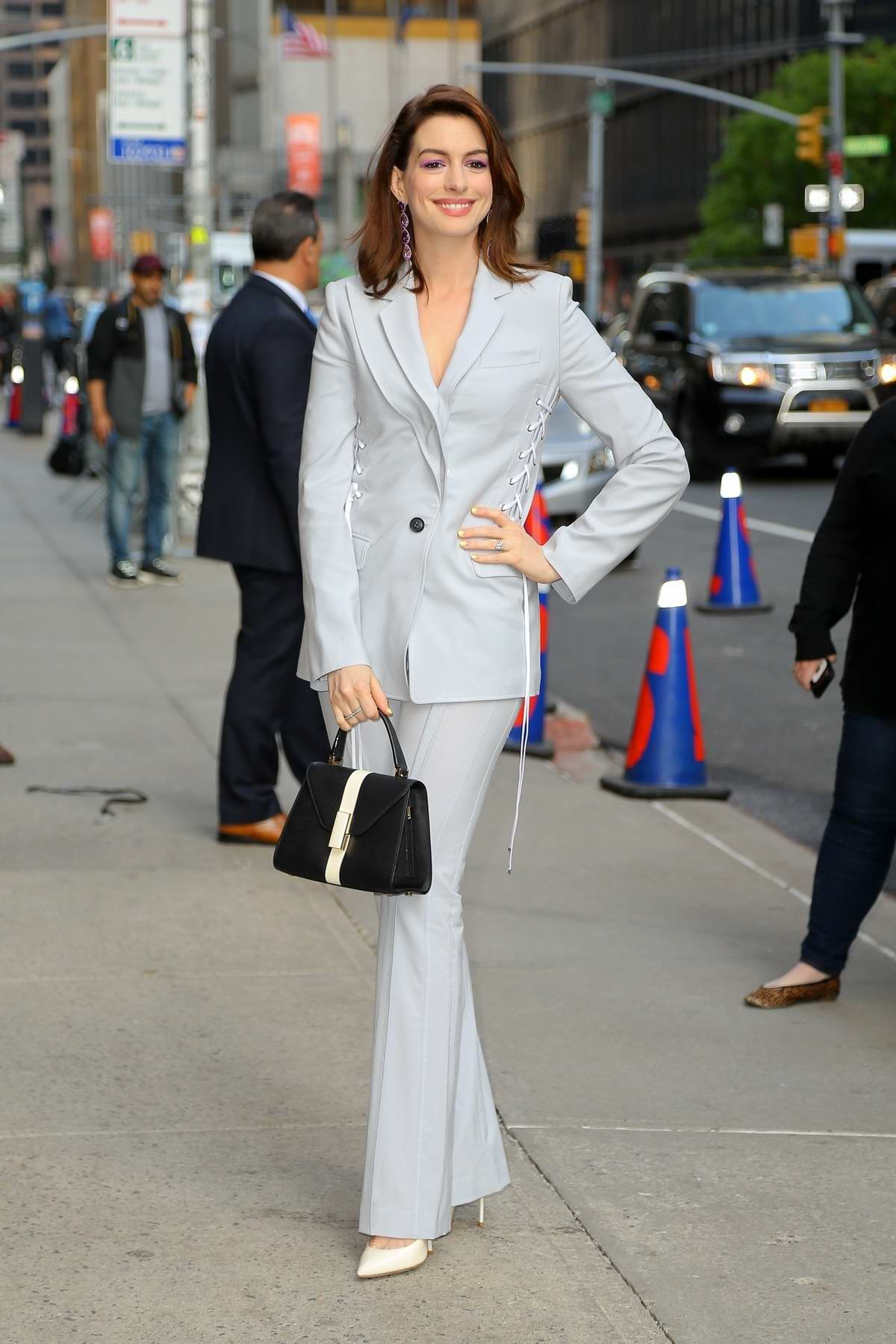 Anne Hathaway looks amazing in a pastel blue suit as she arrives at 'The Late Show With Stephen Colbert' in New York City