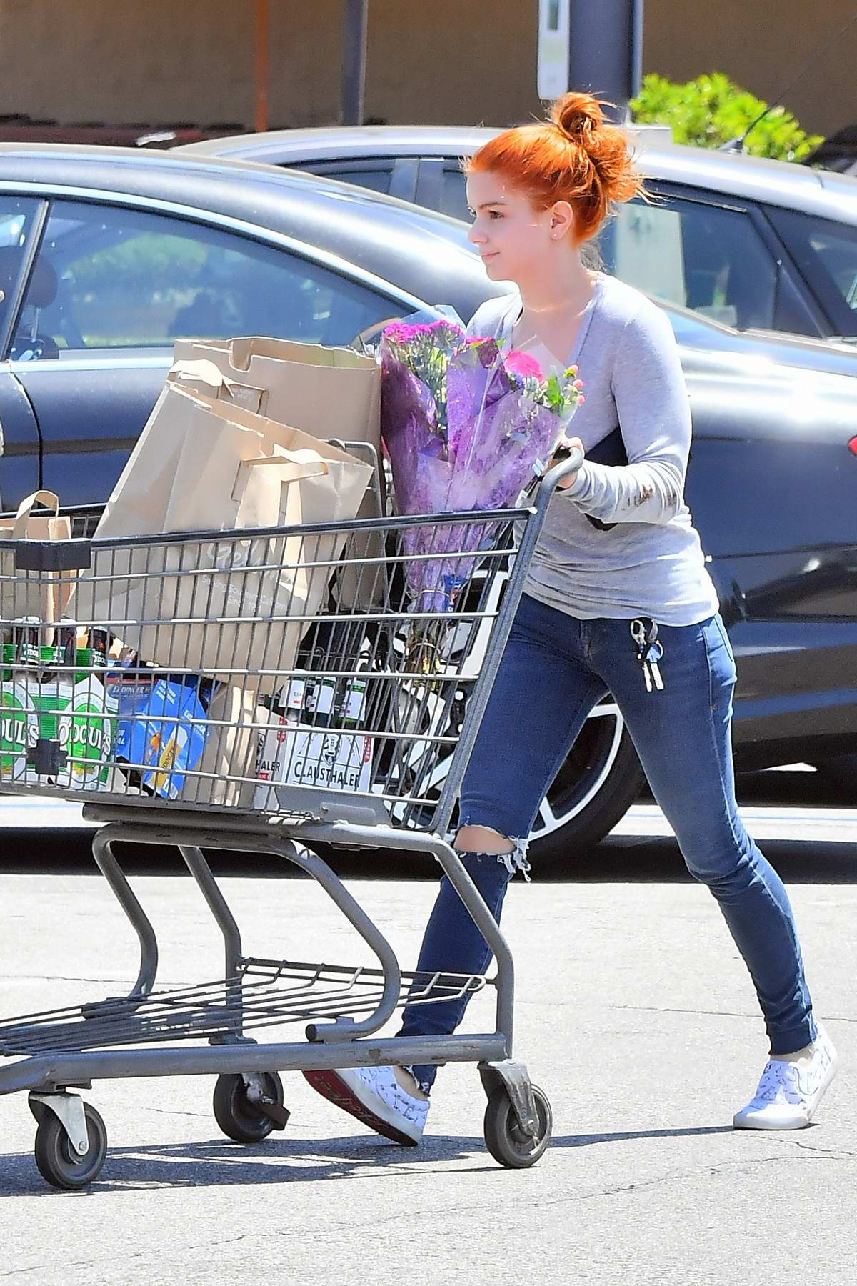 Ariel Winter shops for some groceries, flowers and pack of beers at Gelson's in Studio City, California