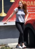 Ariel Winter sports a grey tee and black leggings while out running errands with Levi Meaden in Studio City, Los Angeles