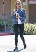 Ashley Benson wears a denim jacket, white tee and black leggings during a coffee run in West Hollywood, Los Angeles
