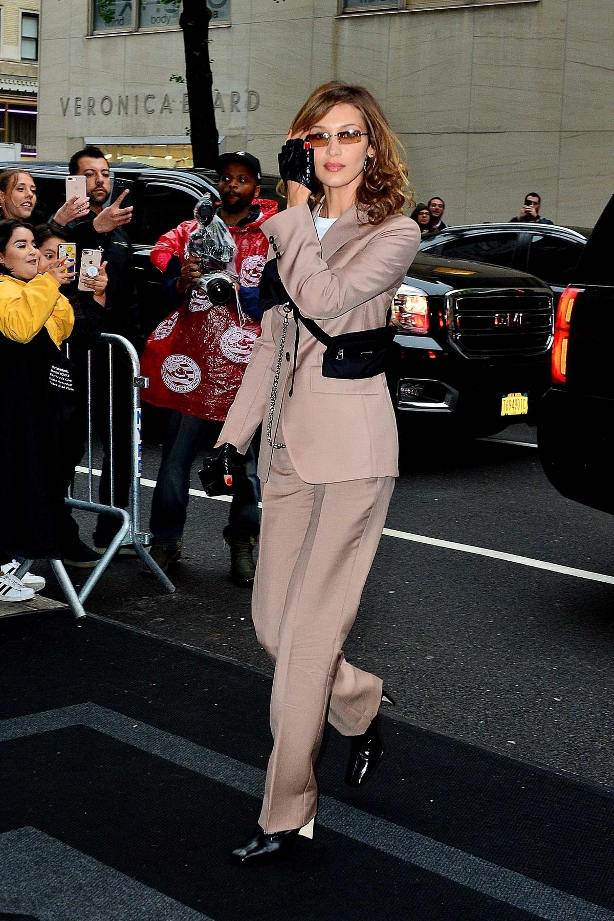 bella hadid looks fantastic in a dusty pink suit as she ...