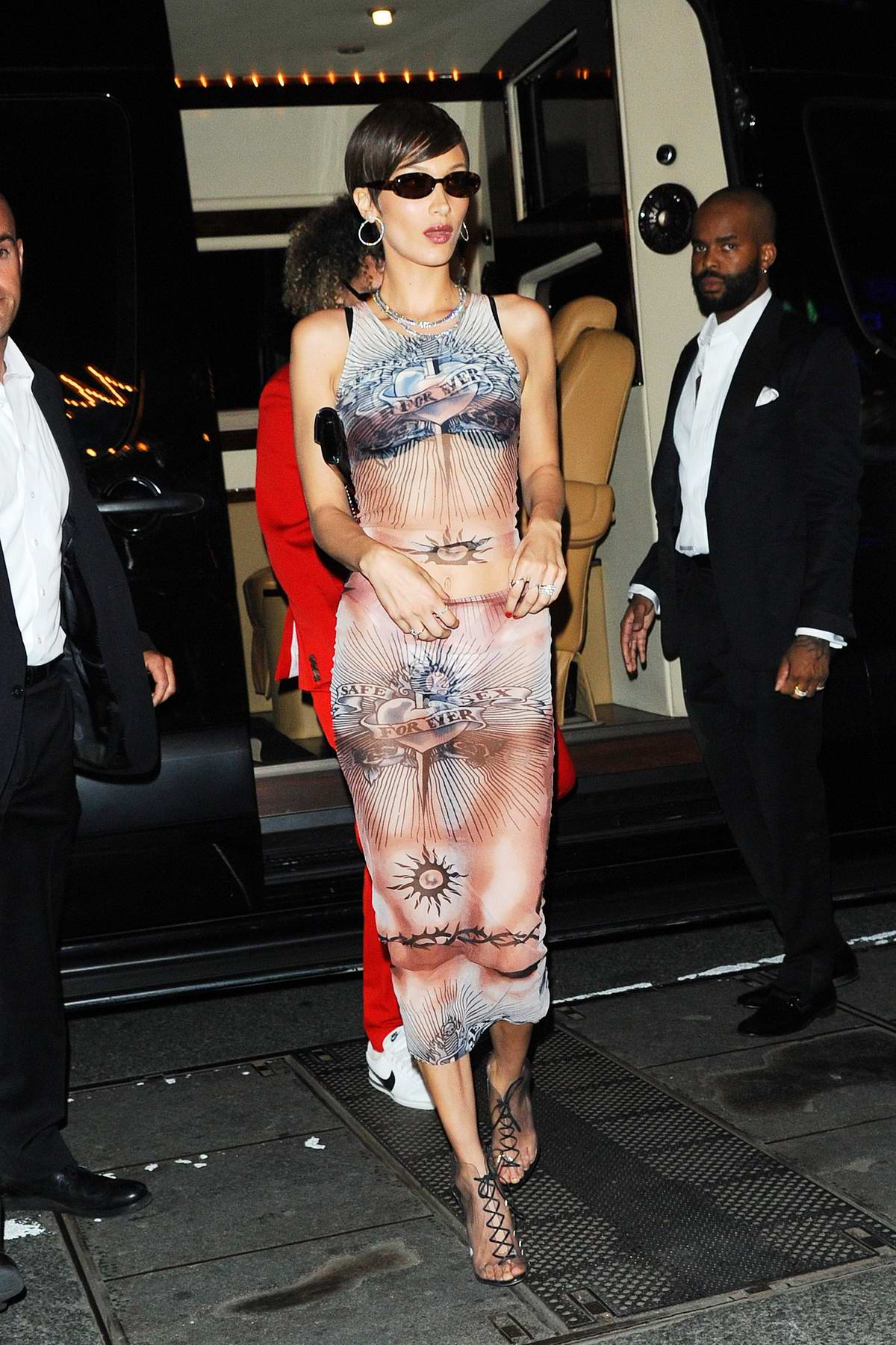 Bella Hadid rocks a graphic semi-sheer outfit as she heads to the 2019 Met Gala after-party in New York City