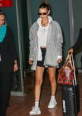 Bella Hadid sports a grey jacket, a white top and black shorts as she touches down at Nice airport, France