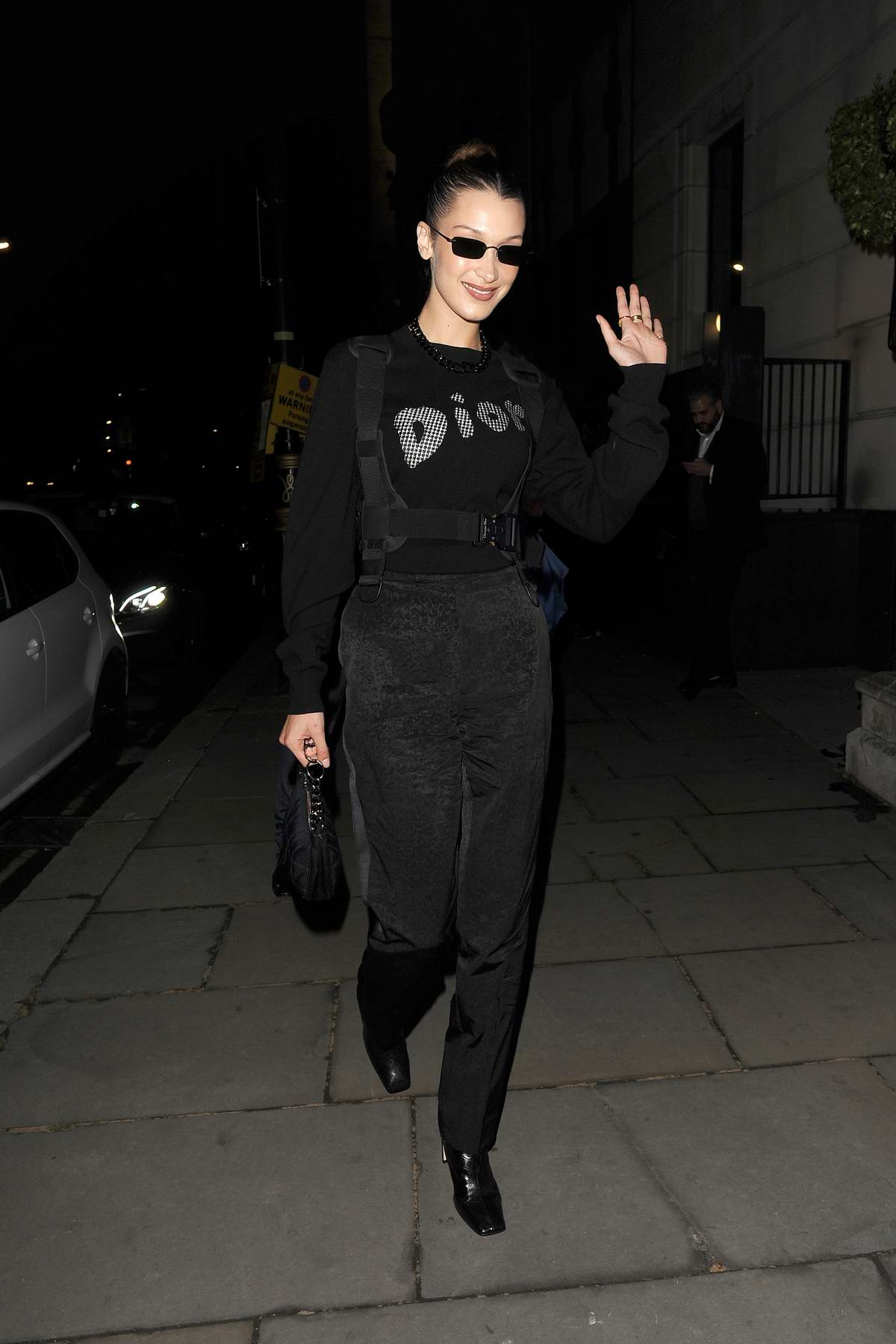 Bella Hadid sports an all-black Dior ensemble as she attends a Christian Dior party in London, UK