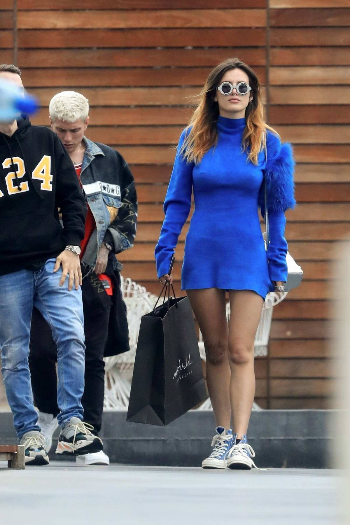 Bella Thorne rocks a blue mini-dress and Chanel sunglasses while out shopping at Maxfield with Benjamin Mascolo in Los Angeles