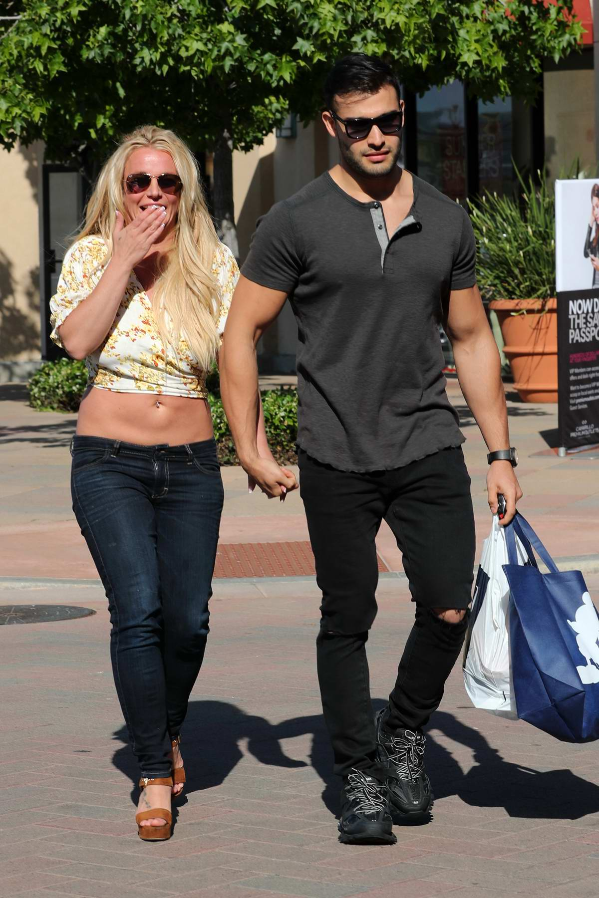 Britney Spears and boyfriend Sam Asghari hold hands while out for shopping at The GAP in Camarillo, California