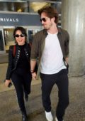 Camila Cabello and boyfriend Matthew Hussey hold hands as they arrive at LAX in Los Angeles