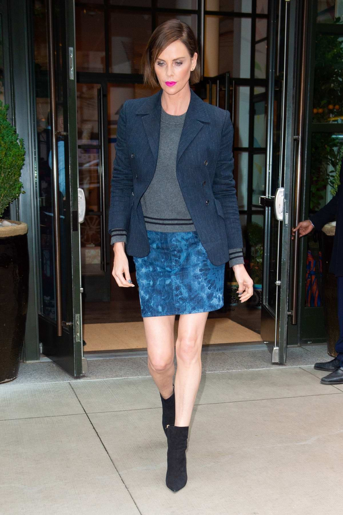 Charlize Theron sports a denim blazer teamed with a denim miniskirt as she heads to 'Late Night with Seth Meyers' in New York City