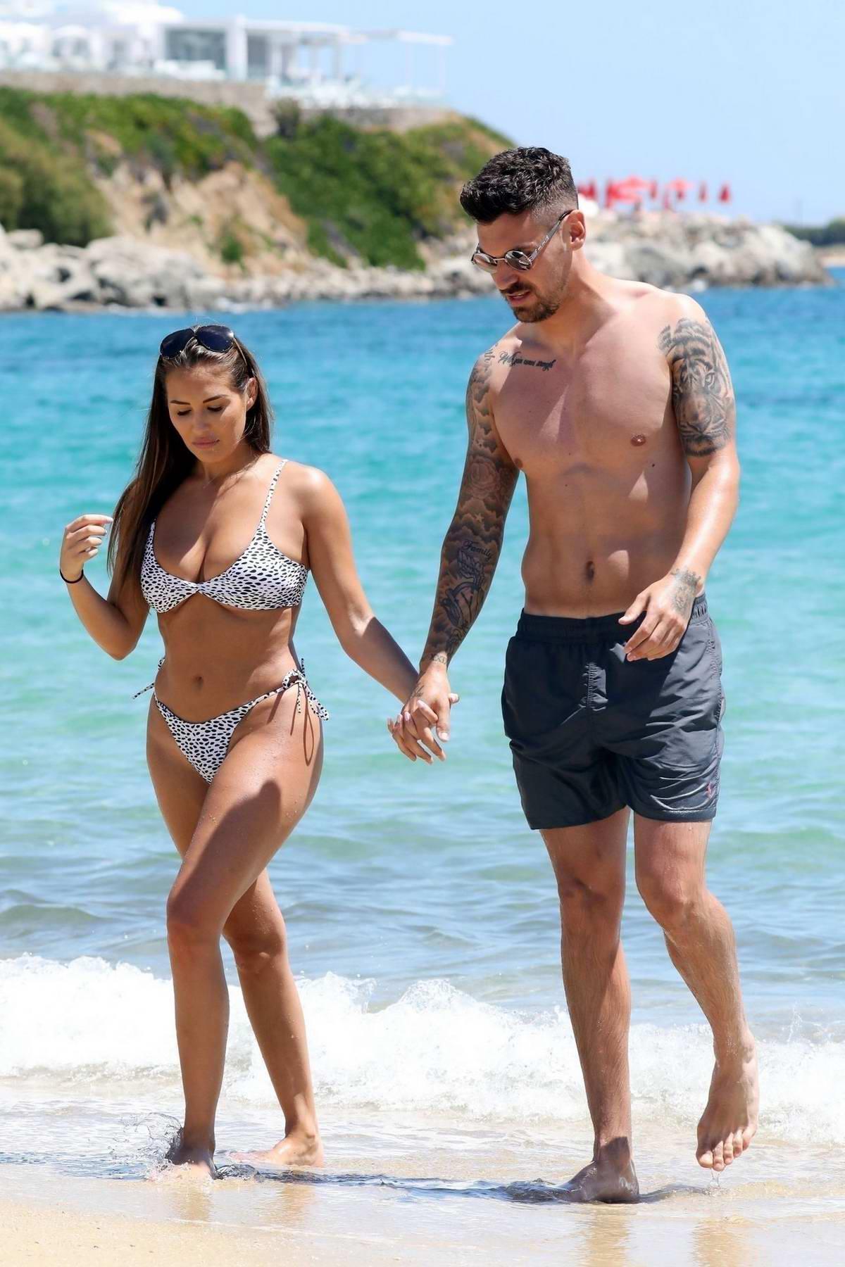 Chloe Goodman spotted in a bikini while enjoying the beach with boyfriend Grant Hall in Mykonos, Greece