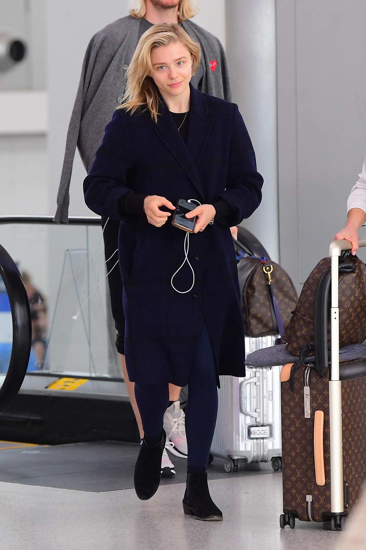 Chloe Grace Moretz looks lovely as she touches down at Newark Airport in New York City