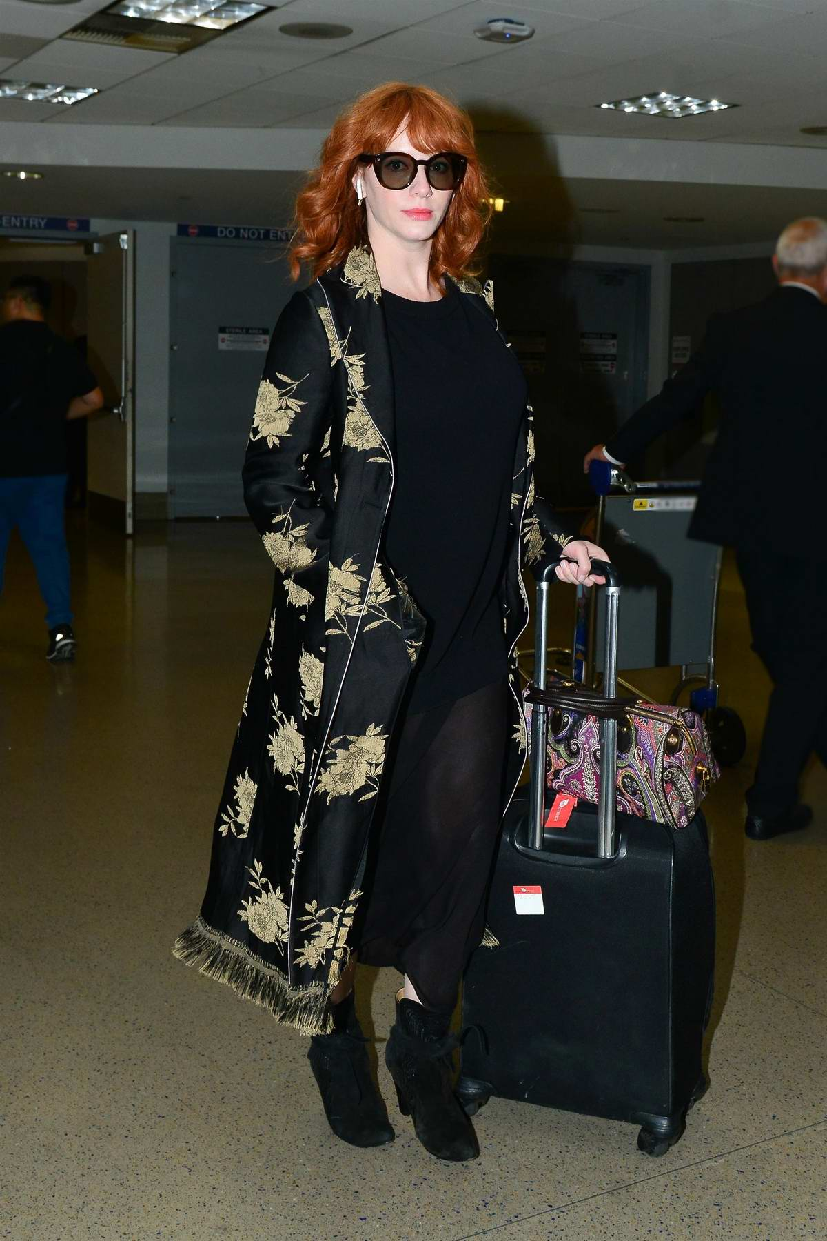 Christina Hendricks makes her way through LAX Airport in Los Angeles