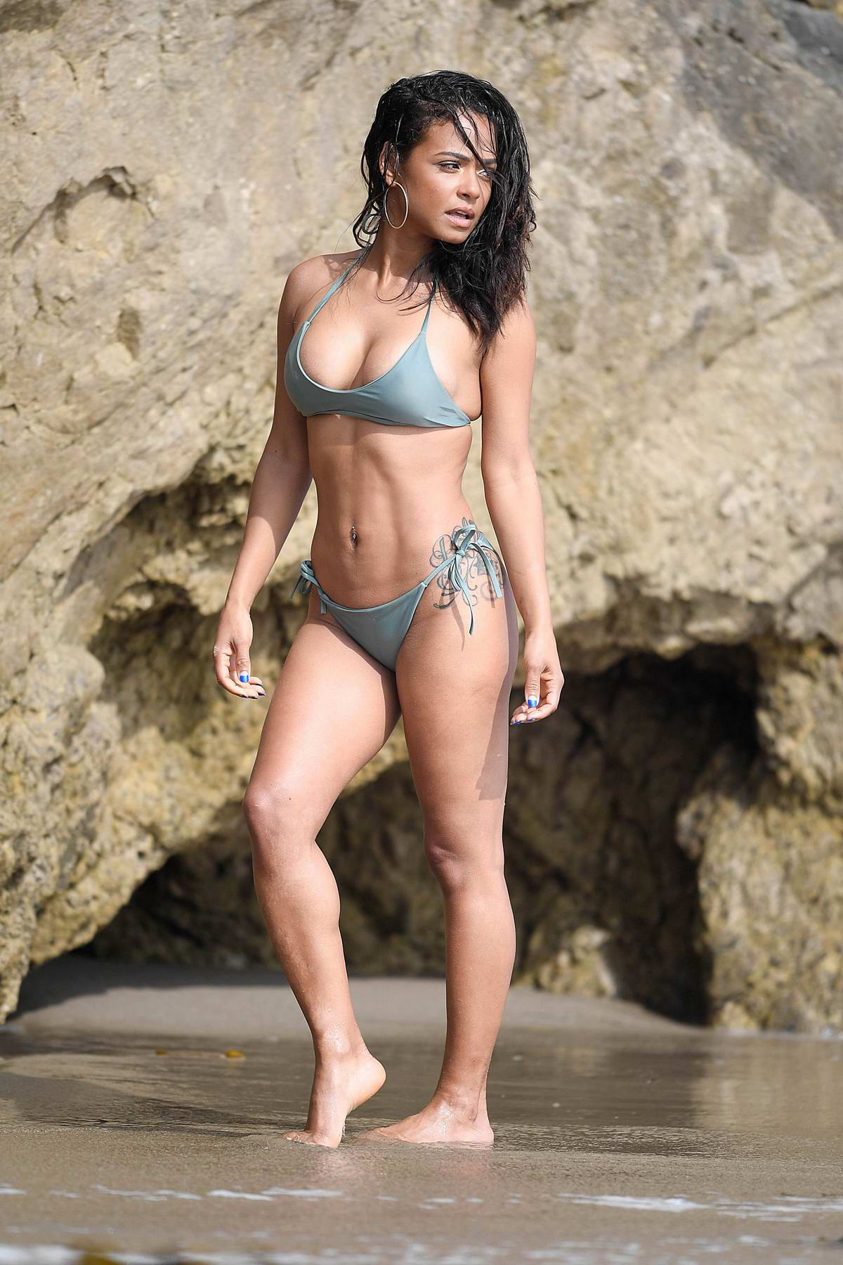 Christina Milian sizzles in multiple bikini and swimsuits during a shoot for 'House Of Fine Gold' swimwear in Malibu, California