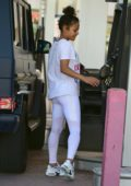 Christina Milian sports a white tee, matching leggings and Nike sneakers as she stops to fill up gas in Los Angeles