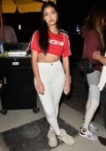 Cindy Kimberly strikes a pose in a red crop top as she attends The Dog Pound Gym opening in West Hollywood, Los Angeles