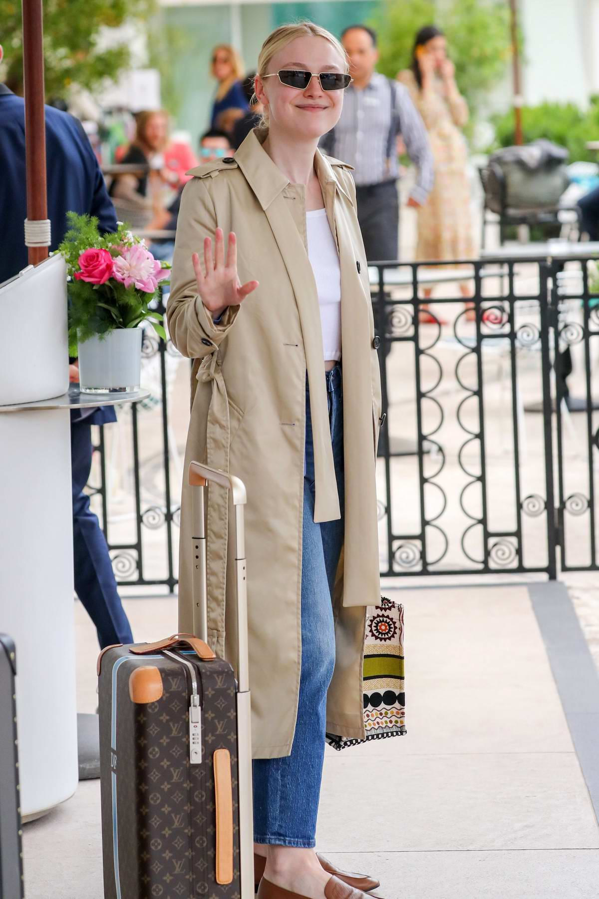 Dakota Fanning seen with her Louis Vuitton suitcase outside the Martinez hotel during the 72nd annual Cannes Film Festival in Cannes, France
