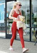 Dakota Fanning sports a red crop top with matching leggings as she hits the gym in Studio City, Los Angeles