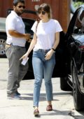 Dakota Johnson dons a simple white tee and jeans while visiting a nail salon before grabbing lunch with Blake Lee in Los Angeles