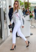 Doutzen Kroes is all smiles as she arrives at the Martinez hotel during the 72nd annual Cannes Film Festival in Cannes, France