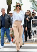 Doutzen Kroes looks chic in a white shirt and beige trousers while out during the 72nd annual Cannes Film Festival in Cannes, France
