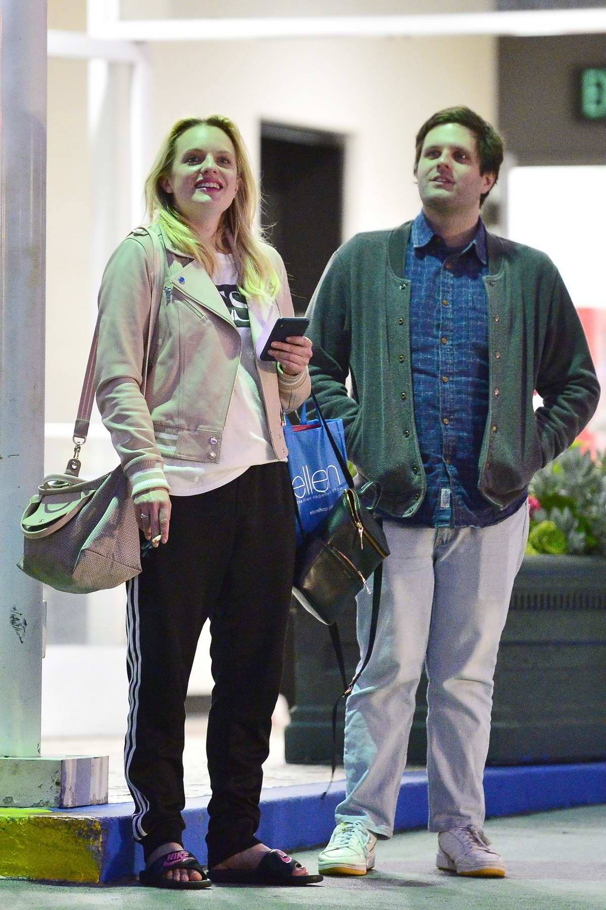 Elisabeth Moss keeps it casual for a dinner outing with a male friend at Sushi Park in Los Angeles