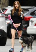 Elizabeth Olsen sports a black top and Under Armour shorts while out for a hike with her dog in the Hollywood Hills, California