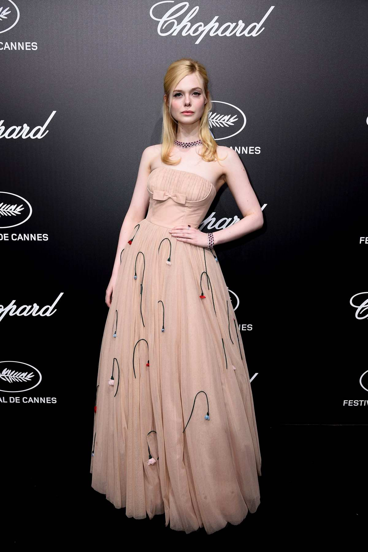Elle Fanning attends the official Trophee Chopard Dinner Photocall during the 72nd annual Cannes Film Festival in Cannes, France